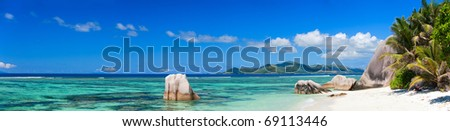 Panorama of beautiful Anse Source d Argent beach in Seychelles - stock photo