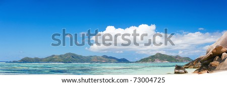 Panorama of beautiful Anse Source d'Argent beach in Seychelles - stock photo
