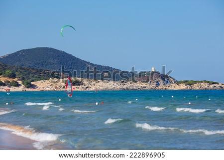 Panorama of beautiful beach with kitesurfer in Sardinia, Italy - stock photo