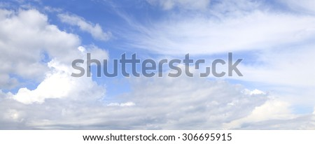 Panorama of Beautiful Cloudscape Including Cumulus and Cirrus Clouds - stock photo