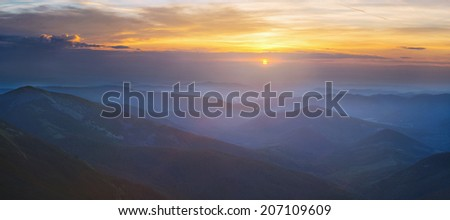 Panorama of beautiful sunrise in mountains landscape. View from Ihrovets mountain in the Carpathian massif