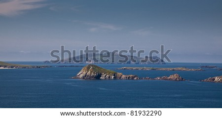 Panorama of Beginish Island and other small islands seen from Dingle Peninsula, Ireland. - stock photo