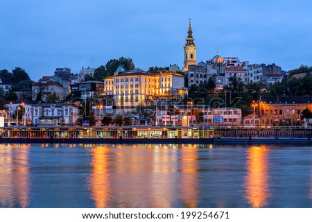 Panorama of Belgrade at night with river Sava - stock photo