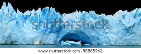 Panorama of blue icebergs isolated on black - stock photo