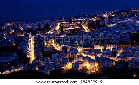 Panorama of blue medina in Chefchaouen city in the night. Morocco, North Africa - stock photo