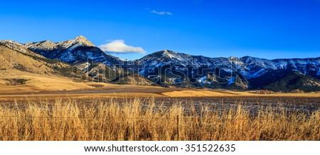 Panorama of Bridger mountain range near Bozeman, Montana. Photographed at sunset. - stock photo
