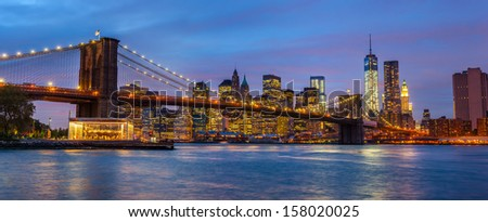 Panorama of Brooklyn Bridge, East River and Manhattan with lights and reflections. New York - stock photo