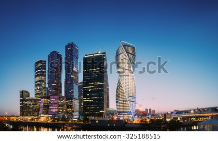 Panorama of Buildings Of Moscow City Complex Of Skyscrapers At Evening  in night illumination, Moscow, Russia. Business Center Of Modern Moscow