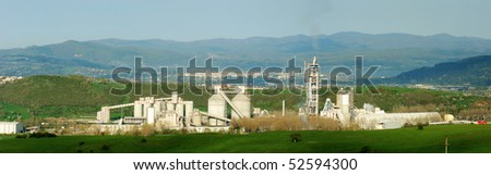 panorama of cement plant and dead vegetation in it's proximity - stock photo