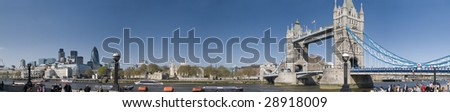 Panorama of Central London, icluding famous landmarks as Tower bridge, The tower of London and the Gherkin and lots of visitors - stock photo