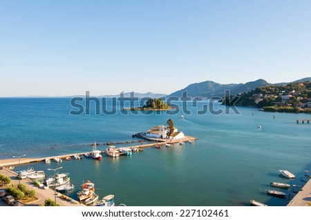 Panorama of Chalikiopoulou Lagoon and Pontikonisi and Vlacheraina monastery seen from the hilltop of Kanoni on the island of Corfu, Greece. - stock photo