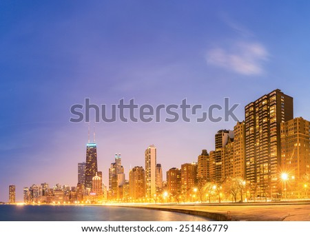Panorama of City of Chicago downtown and Lake Michigan at dusk - stock photo
