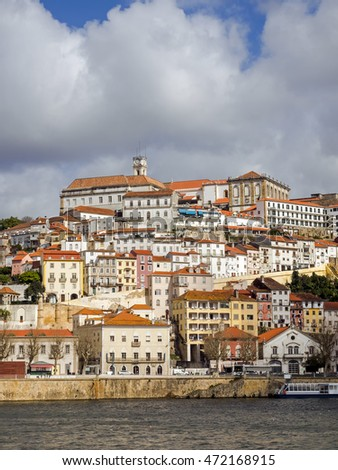 Panorama of Coimbra, Portugal, with river Mondego in the foreground