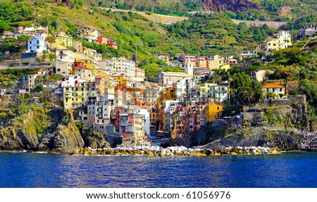 Panorama of colourful houses in Riomaggiore at Cinque Terre - stock photo
