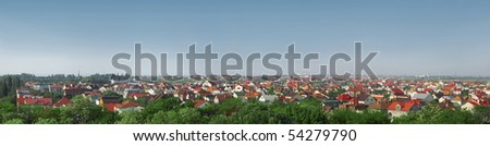 Panorama of cottage suburban settlement with green trees - stock photo
