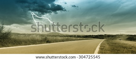 panorama of countryside with clouds and lightning