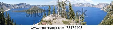 Panorama of Crater Lake, Oregon with danger warning sign - stock photo