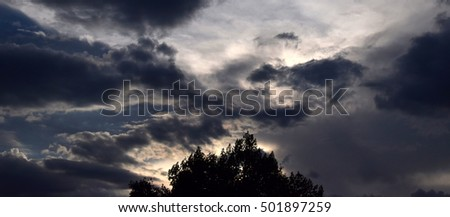 Panorama of dark clouds with lots of contrasting clouds