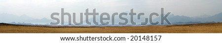 Panorama of desert and hills with blue sky - stock photo