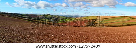 Panorama of Devon countryside looking towards Dartmoor UK with Stokeinteignhead village in the foreground - stock photo