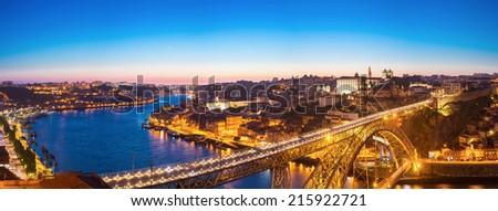 Panorama of Dom Luiz bridge in Porto Portugal at dusk - stock photo