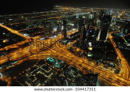 Panorama of down town Dubai modern city at night - stock photo