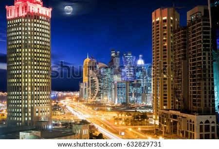 Panorama of downtown City Center Doha, Qatar, during night with moon