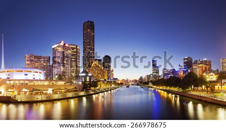 Panorama of downtown Melbourne at night, produced by stitching several images together - stock photo
