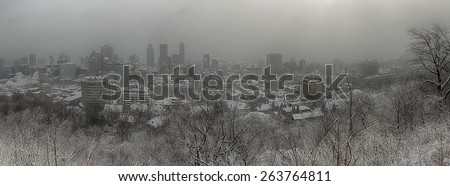 Panorama of downtown Montreal during winter snowstorm from the mont royal mountain. - stock photo