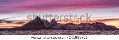 Panorama of Dramatic sunset over Antarctica peninsula - stock photo