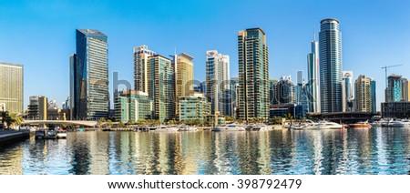 Panorama of Dubai Marina in a summer day, UAE - stock photo