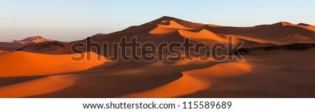 Panorama of dunes in the Sahara at sunset, Tin Merzouga, Algeria - stock photo