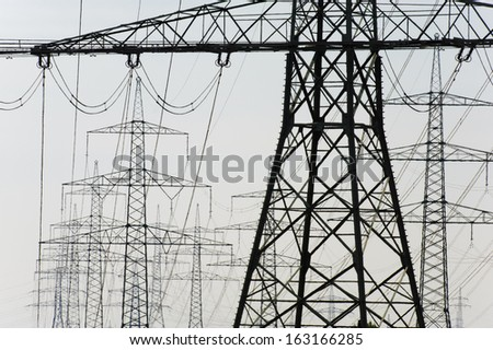 panorama of electric power poles - stock photo