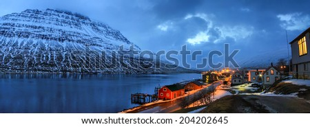 Panorama of Eskifjordur settlement, located in a fjord in eastern Iceland - stock photo