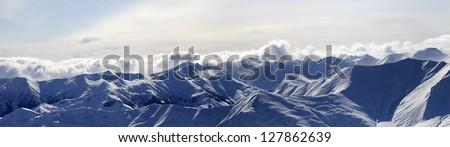 Panorama of evening mountains in haze. Caucasus Mountains, Georgia, view from ski resort Gudauri. - stock photo