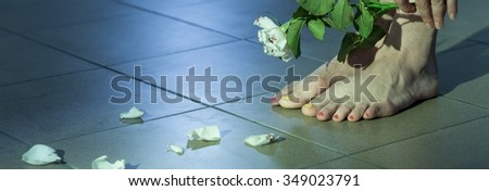 Panorama of female rape victim with suicidal ideation - stock photo