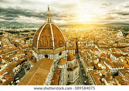 Panorama of Florence, Italy. The Basilica di Santa Maria del Fiore (Basilica of Saint Mary of the Flower) in the foreground. - stock photo