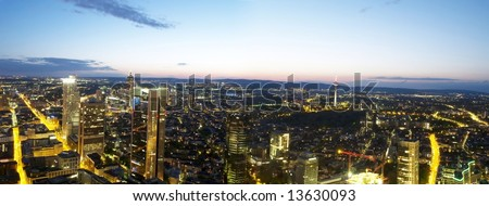 Panorama of Frankfurt city at night - stock photo