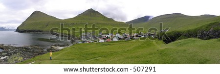 Panorama of Gjogv, Faroe Island. A little village between the mountains and the sea. - stock photo