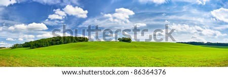 panorama of green fields and beautiful blue sky - stock photo