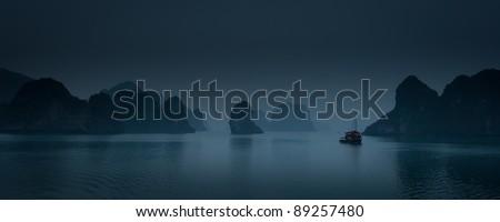 Panorama of Ha Long Bay after sunset, Vietnam - stock photo