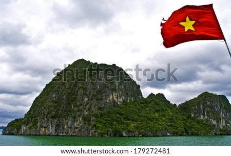 Panorama of Ha Long Bay and Vietnamese flag, Ha Long Bay, Vietnam - stock photo
