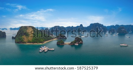 Panorama of Halong Bay Vietnam. Panoramic view of Ha Long islands, tourist junks, rock mountains and tropical sea water of famous landmark in Asia  - stock photo