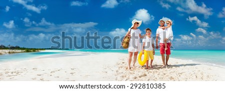 Panorama of happy beautiful family with kids walking together on tropical beach during summer vacation - stock photo