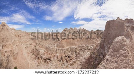 panorama of heavy erosion in badlands national park - stock photo