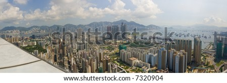 Panorama of Hong Kong and Kowloon from Mong Kok. Foreground features dense apartment blocks, Victoria Harbour and Hong Kong Central Business District.
