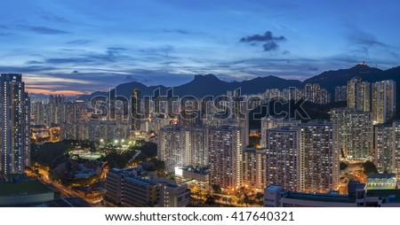 Panorama of Hong Kong City skyline and Lion Rock Hill at dusk - stock photo