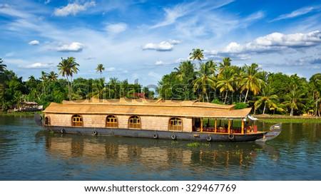 Panorama of houseboat on Kerala backwaters. Kerala, India - stock photo