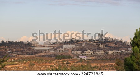 Panorama of houses on the outskirts of Hebron during sunrise
