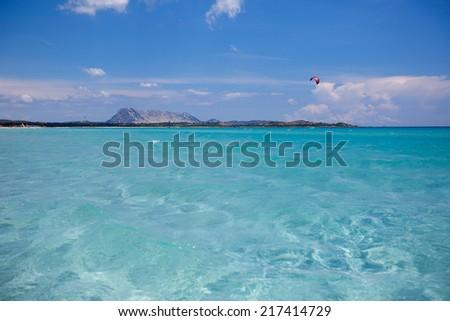 Panorama of idyllic beach with turquoise water - stock photo